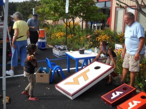 Charlie at the Good Food For All Fest Appalachian Sustainable Development event playing cornhole with the kids.
